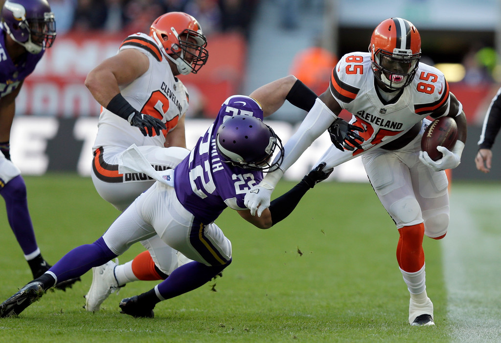 . Cleveland Browns tight end David Njoku (85) is tackled by Minnesota Vikings safety Harrison Smith (22) during the first half of an NFL football game at Twickenham Stadium in London, Sunday Oct. 29, 2017. (AP Photo/Tim Ireland)