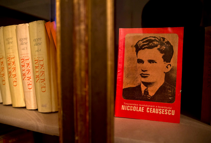 """. A picture taken on Dec. 15, 2014 shows books and magazines, either about or allegedly authored by communist dictator Nicolae Ceausescu, at the military garrison, turned museum, in Targoviste, Romania, where he and his wife Elena spent their final days before being executed on Dec. 25, 1989. Title reads \""""The revolutionary youth of comrade Nicolae Ceausescu\"""".  (AP Photo/Vadim Ghirda)"""