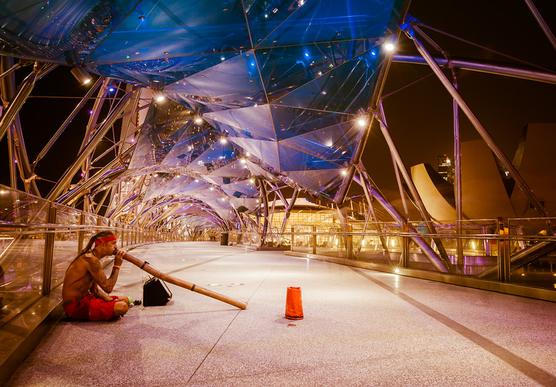 Didgeridoo Player on the Helix Bridge in Singapore