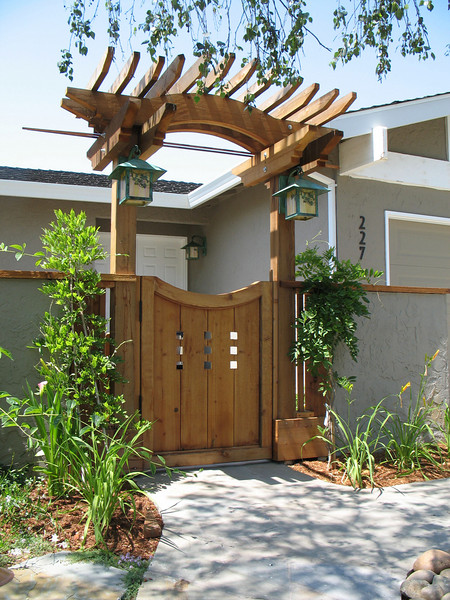 Welcome to the House of Green Lanterns. The arbor lights are from Arroyo Craftsman and have a copper vertigris patina.