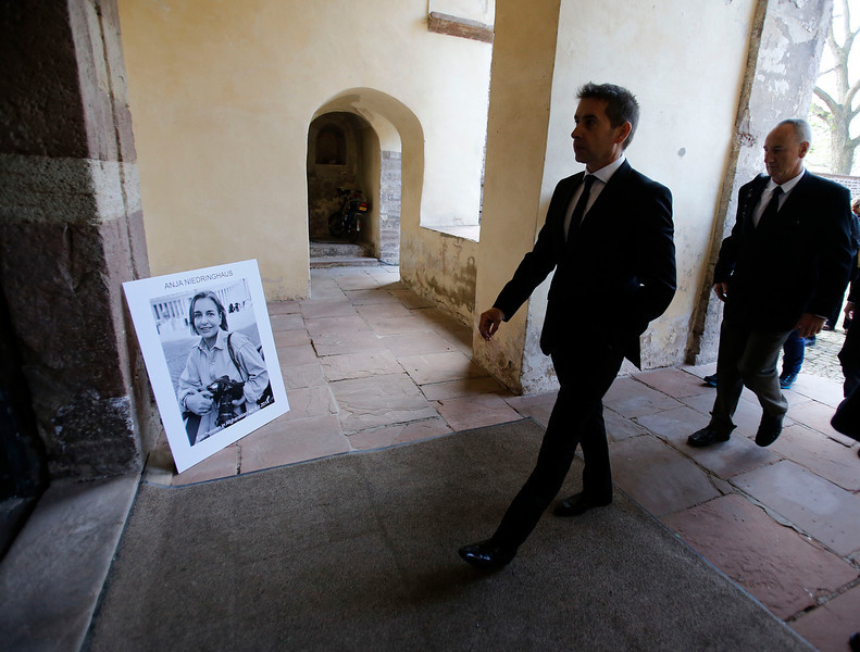 . Mourners arrive at Corvey Abbey to attend the funeral of Associated Press photojournalist Anja Niedringhaus in Hoexter, Germany, Saturday, April 12, 2014. Niedringhaus was killed by an Afghan policeman in an attack on April 4, 2014 in Afghanistan. (AP Photo/Frank Augstein, pool)