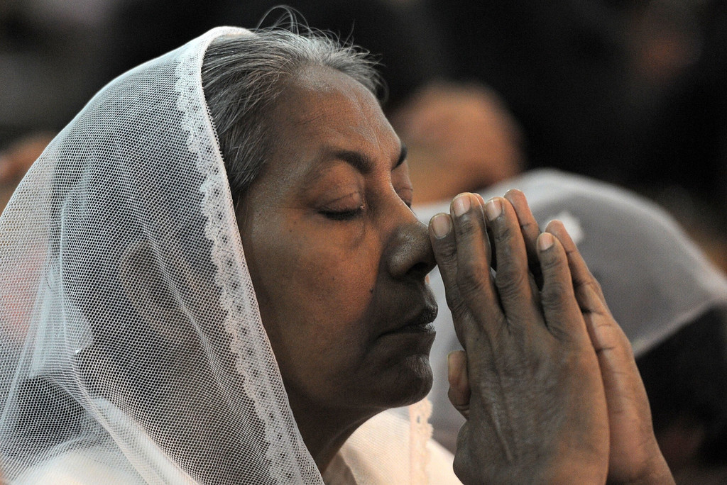 . A Christian devotee prays during a Christmas mass in Colombo early on December 25, 2013. Christians account for some 6 per cent of Sri Lanka\'s 21 million population.    LAKRUWAN WANNIARACHCHI/AFP/Getty Images
