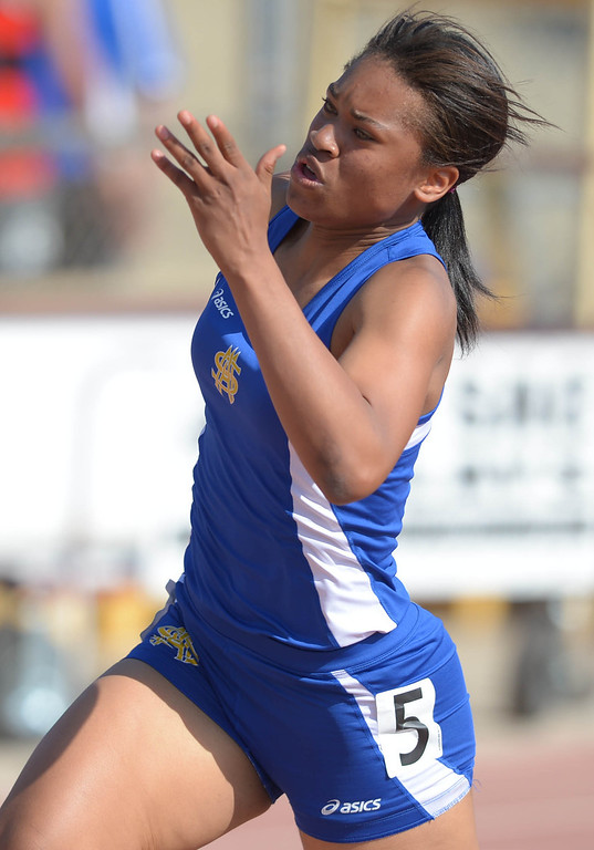 . St. Mary\'s Academy\'s Sierra Peterson takes the turn to win the 200 meter Division 4 race of the CIF Southern Section Track and Field Championships Saturday at Mt. SAC. 20130518 Photo by Steve McCrank / Staff Photographer