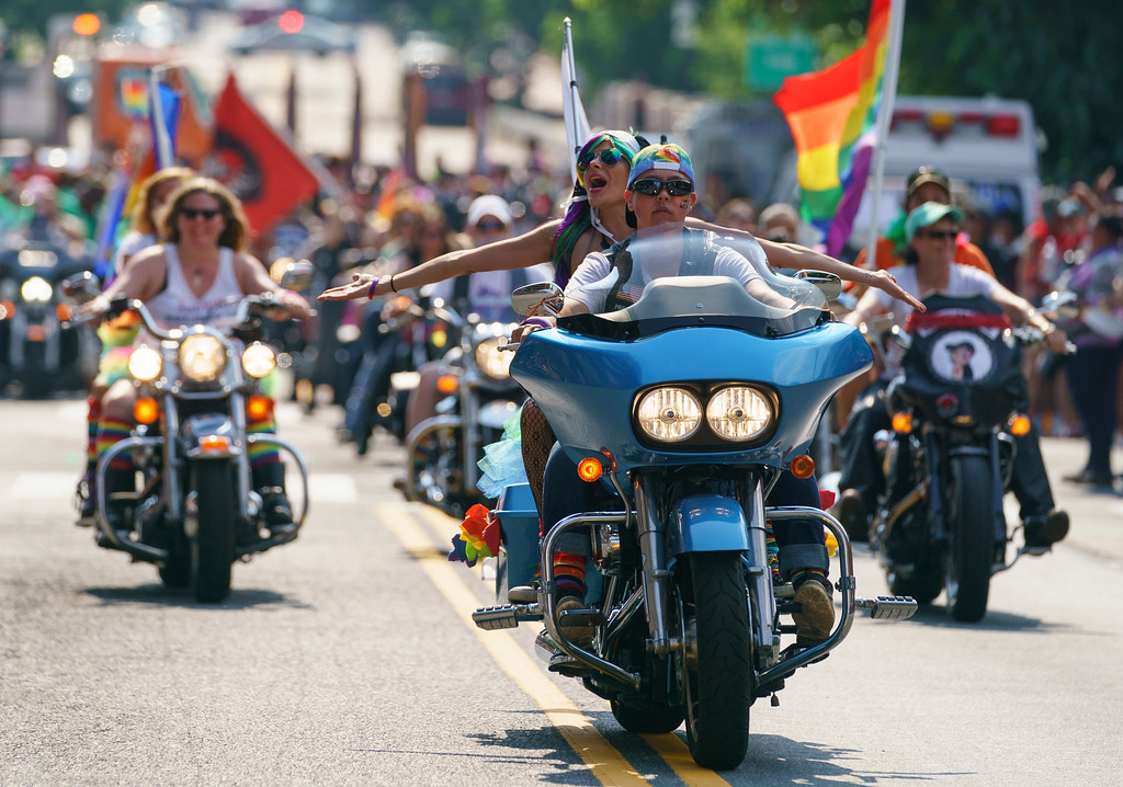 . Tammy Kronebusch, president of the Out Riders Women\'s Motorcycle Club, and her passenger Veronica Simbulan, left, prepare to lead the Capital Pride Parade in Washington, Saturday, June 9, 2018. The yearly event is hosted by and in support of the LGBTQ+ community and moves through the Dupont Circle and Logan Circle neighborhoods of Washington. (AP Photo/Carolyn Kaster)