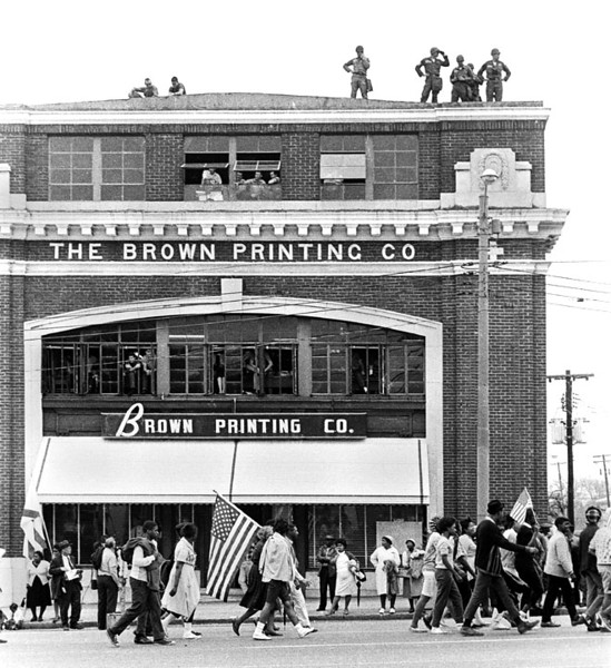 """Rooftop U.S. Army troops guarding marchers passing in front of """"THE BROWN PRINTING COMPANY""""  Selma to Montgomery, Alabama Civil Rights March, March 25, 1965"""
