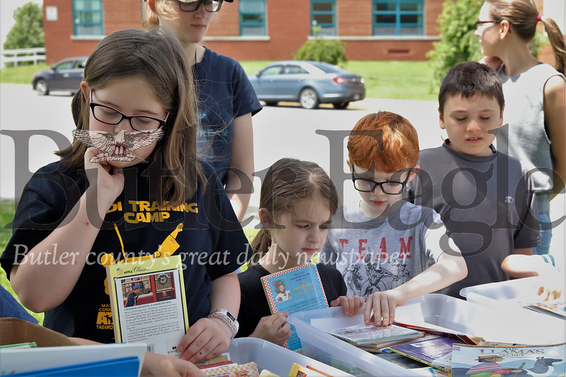 Isabelle Colonna, 10, of Butler (left) and her sister Abigail browse for books at the Butler School District Book Swap. Seb Foltz/Butler Eagle