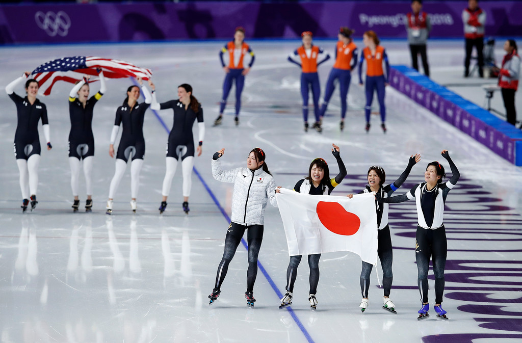 . Gold medalist team Japan, front, and bronze medalist team U.S.A. celebrate, while silver medalist team Netherlands appears dejected after the women\'s team pursuit speedskating race at the Gangneung Oval at the 2018 Winter Olympics in Gangneung, South Korea, Wednesday, Feb. 21, 2018. (AP Photo/Vadim Ghirda)