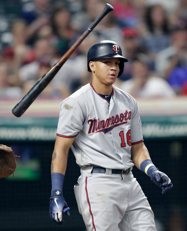 . Minnesota Twins\' Ehire Adrianza throws his bat after striking out against Cleveland Indians relief pitcher Oliver Perez in the sixth inning of a baseball game, Wednesday, Aug. 29, 2018, in Cleveland. (AP Photo/Tony Dejak)