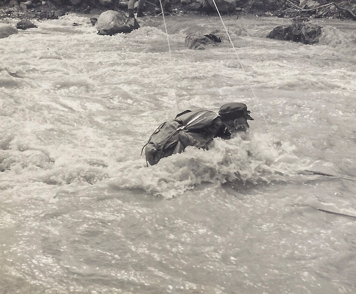 1956 JER Mathews crossing Otaki River on Search & Rescue mission a.jpg