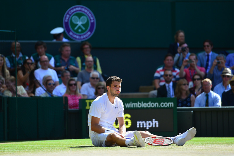 . Bulgaria\'s Grigor Dimitrovreacts to losing a point against Serbia\'s Novak Djokovic during their men\'s singles semi-final match on day 11 of  the 2014 Wimbledon Championships at The All England Tennis Club in Wimbledon, southwest London, on July 4, 2014. (CARL COURT/AFP/Getty Images)