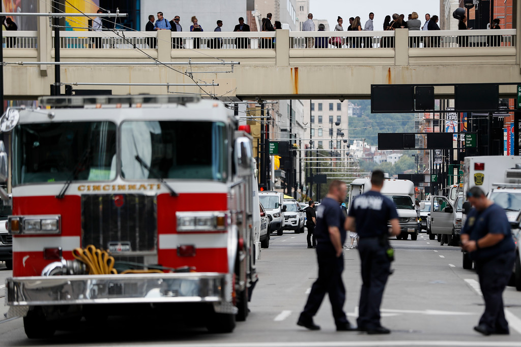 . Civilians are escorted from the Fifth Third Center as emergency personnel and police work the scene of shooting near Fountain Square, Thursday, Sept. 6, 2018, in downtown Cincinnati. (AP Photo/John Minchillo)