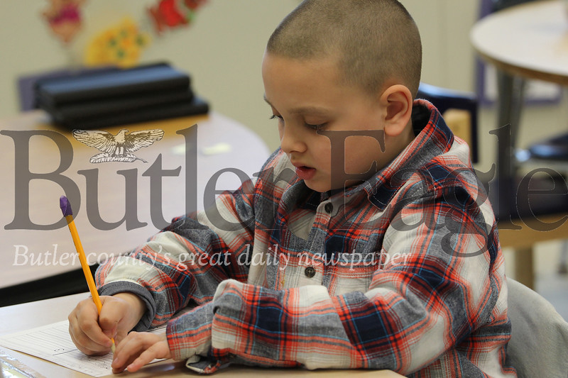 McQuistion Elementary School first grader Kaleb Kormick works on his Mother's Day letter. Seb Foltz/Butler Eagle