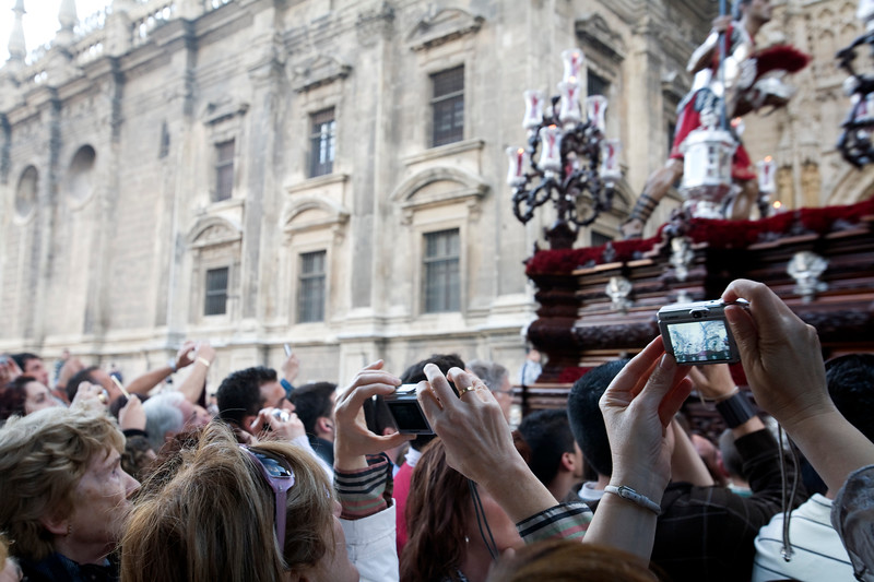 People taking photographs of a float, Holy Week, Seville, Spain