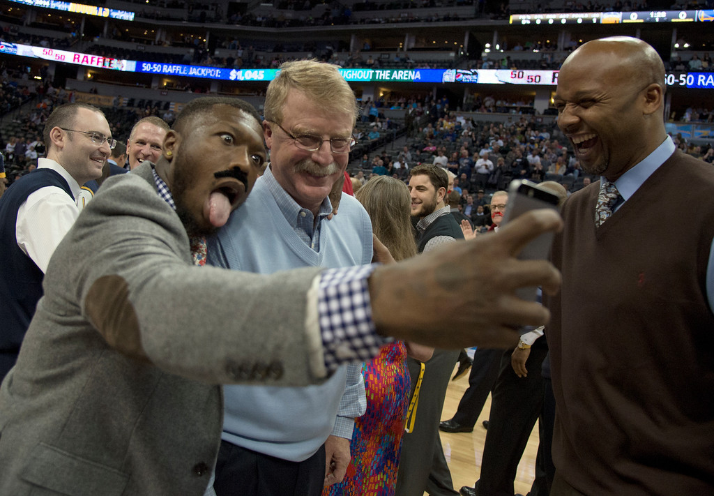 . DENVER, CO - APRIL 16: Denver Nuggets Nate Robinson takes a selfie with Denver Nuggets trainer  Jim Gillen, who will retire after 23 seasons with the team April 16, 2014 at Pepsi Center. Denver Nuggets head coach Brian Shaw laughs during the selfie photo shoot. (Photo by John Leyba/The Denver Post)