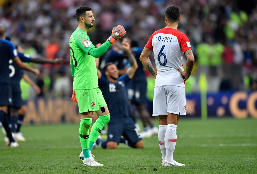 . Croatia goalkeeper Danijel Subasic, left, comforts his teammate Dejan Lovren after losing the final match between France and Croatia at the 2018 soccer World Cup in the Luzhniki Stadium in Moscow, Russia, Sunday, July 15, 2018. (AP Photo/Martin Meissner)