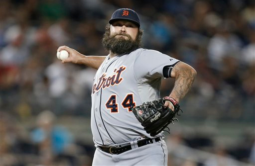 . Detroit Tigers relief pitcher Joba Chamberlain throws to firsts to put out a runner in a baseball game against the New York Yankees at Yankee Stadium in New York, Tuesday, Aug. 5, 2014.  (AP Photo/Kathy Willens)