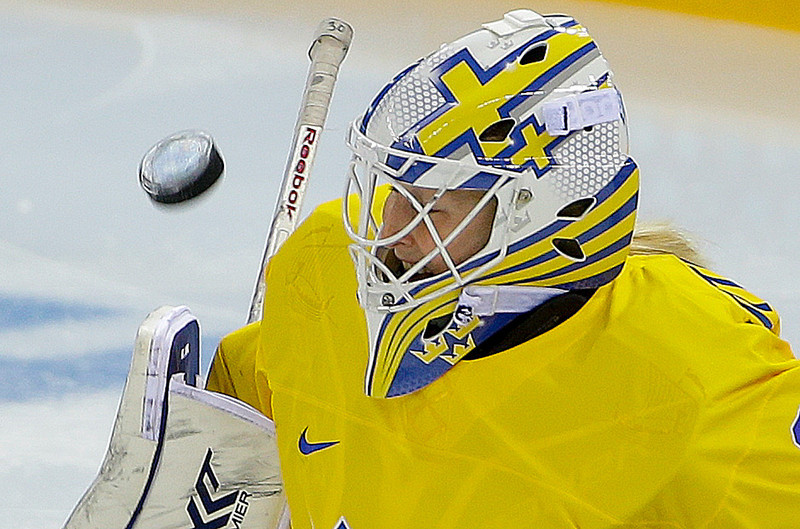 . Goalkeeper Kim Martin Hasson of Sweden blocks a shot by the USA during the third period of the 2014 Winter Olympics women\'s semifinal ice hockey game at Shayba Arena, Monday, Feb. 17, 2014, in Sochi, Russia. (AP Photo/Matt Slocum)
