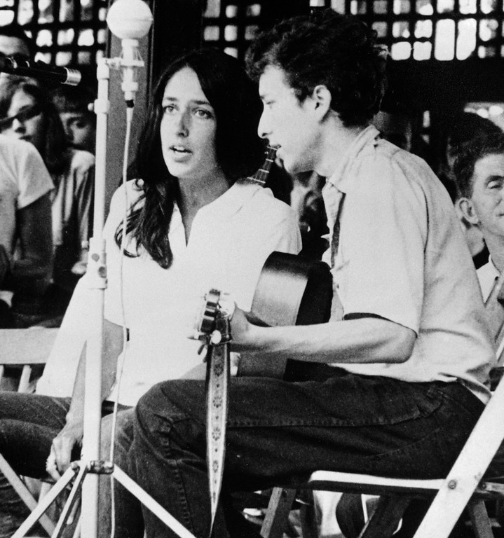 . FILE - In this 1963 file photo, Joan Baez and Bob Dylan perform at the Newport Jazz Festival in Newport, R.I. Two years later, on the night of July 25, 1965, Dylan strode onto a stage at the Newport Folk Festival, plugged in an electric guitar and gave the music world a shock. Fifty years later, it�s considered one of the most important events in rock history, the high-voltage moment when Dylan broke from folk and helped show his fellow musicians the poetic possibilities of rock.  (AP Photo, File)