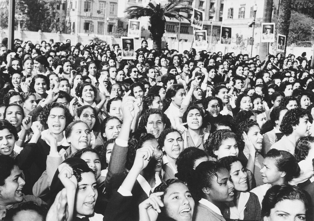 . This crowd of enthusiastic female admirers of Gamal Abdel Nasser gathered outside his Cairo residence on Jan. 22, 1956, to cheer him after he proclaimed a new Egyptian constitution that promised new rights for women. The feminine contingent hopes the right to vote will be one of their new liberties. (AP Photo)
