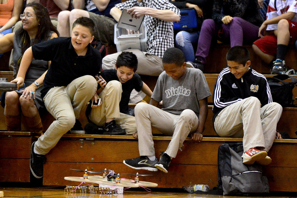 ". Children avoid competing robots as teams of mechanical engineering Caltech students compete in the annual ME72 Engineering Design Contest at the Pasadena campus Tuesday, March 11, 2014. The goal in ""Raiders of the Lost Can\"" was to move their team\'s can closest to the center of a platform. (Photo by Sarah Reingewirtz/Pasadena Star-News)"