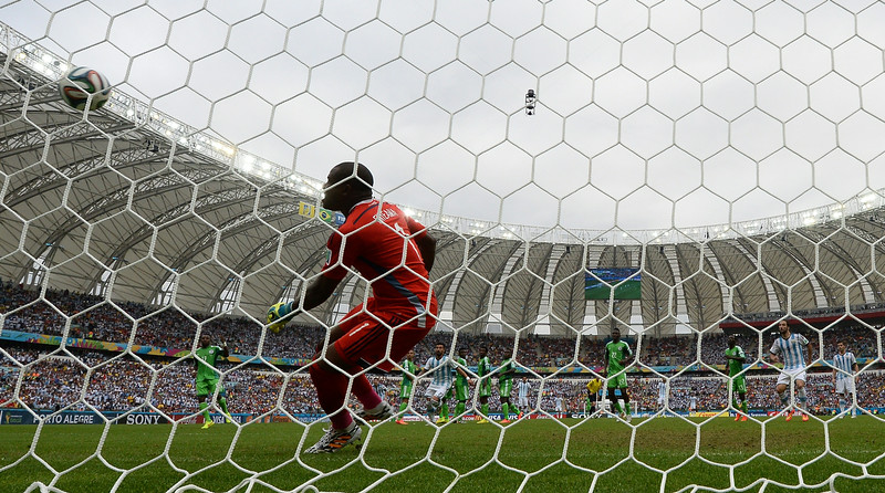 . Nigeria\'s goalkeeper Vincent Enyeama looks on as Argentina\'s forward and captain Lionel Messi scores from a free-kick during the Group F football match between Nigeria and Argentina at the Beira-Rio Stadium in Porto Alegre on June 25, 2014,during the 2014 FIFA World Cup. (JEWEL SAMAD/AFP/Getty Images)