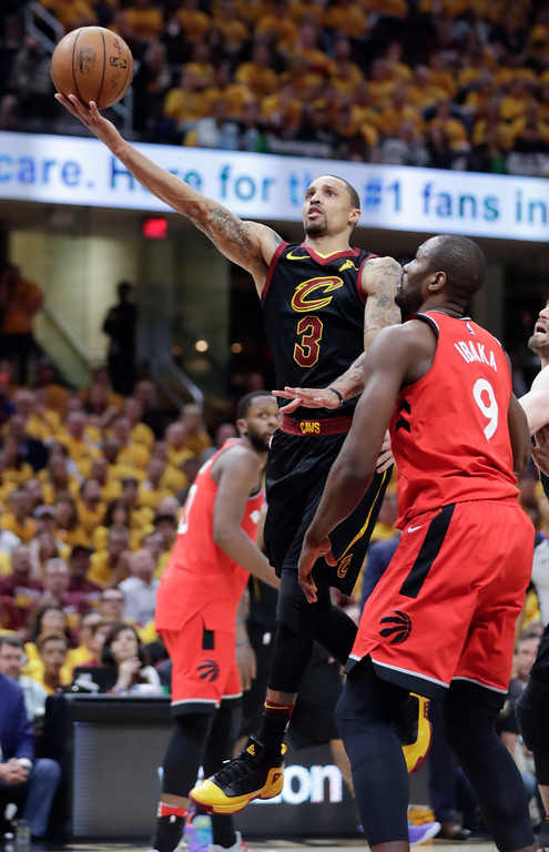 . Cleveland Cavaliers\' George Hill (3) shoots against Toronto Raptors\' Serge Ibaka (9), from Republic of Congo, in the first half of Game 4 of an NBA basketball second-round playoff series, Monday, May 7, 2018, in Cleveland. (AP Photo/Tony Dejak)