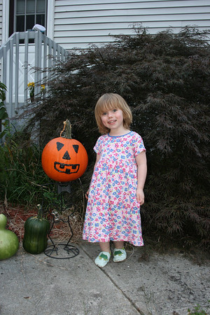 Gracie Posing with the Pumpkins