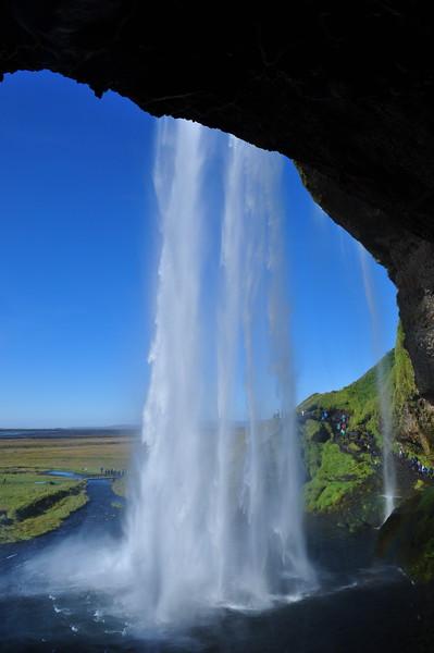 behind waterfall.JPG