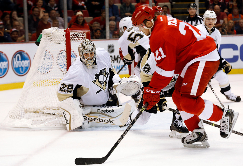 . Pittsburgh Penguins goalie Marc-Andre Fleury (29) prepares to stop a shot by Detroit Red Wings left wing Tomas Tatar (21), of Slovakia, in the second period of a NHL preseason hockey game in Detroit Wednesday, Oct. 1, 2014. (AP Photo/Paul Sancya)