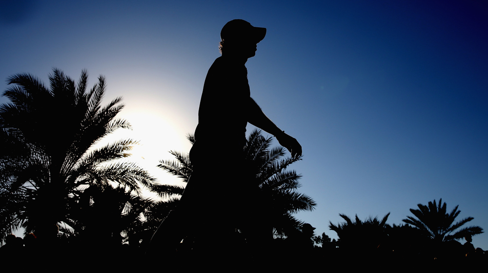 . Rory McIlroy of Northern Ireland walks off of the 18th tee during the second round of the Abu Dhabi HSBC Golf Championship at the Abu Dhabi Golf Club on January 18, 2013 in Abu Dhabi, United Arab Emirates.  (Photo by Ross Kinnaird/Getty Images)
