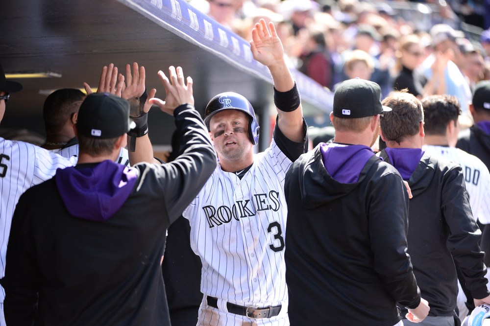 . Michael Cuddyer returns to the dugout after scoring on a triple by Carlos Gonzalez during the third inning. The Colorado Rockies hosted the Arizona Diamondbacks in the Rockies season home opener at Coors Field in Denver, Colorado Friday, April 4, 2014. (Photo by Hyoung Chang/The Denver Post)