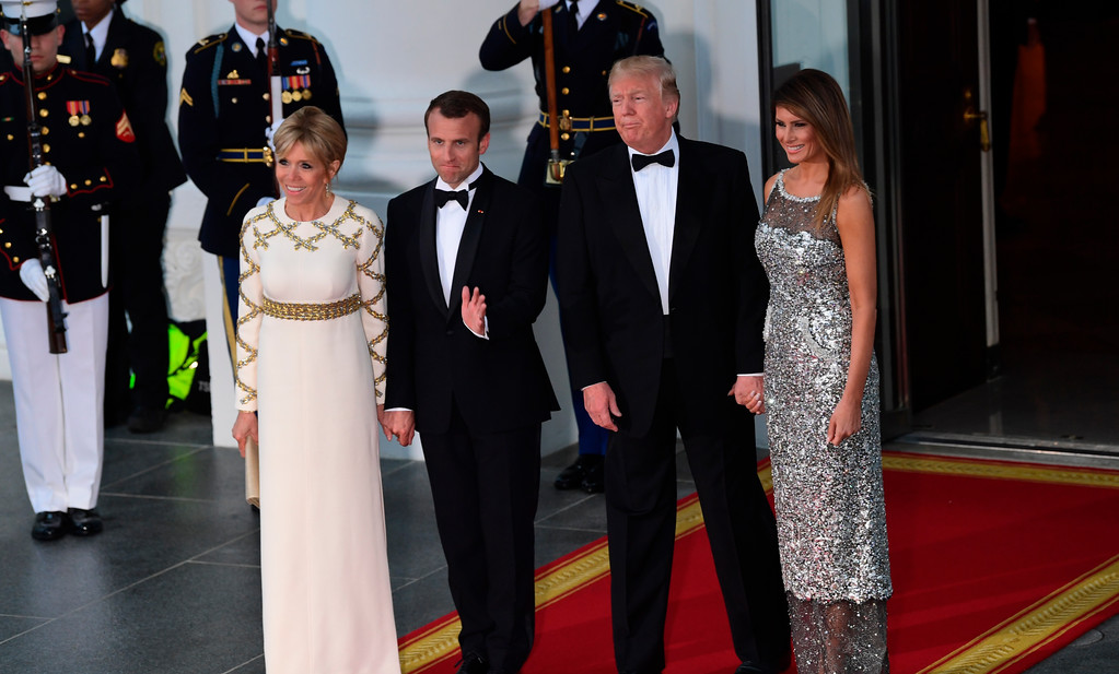 . President Donald Trump and first lady Melania Trump pose for a photo with French President Emmanuel Macron and his wife Brigitte Macron as they arrive for a State Dinner at the White House in Washington, Tuesday, April 24, 2018. (AP Photo/Susan Walsh)