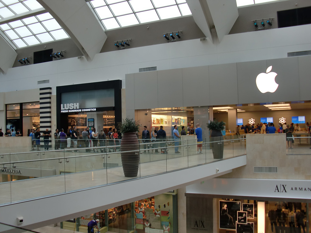 . The iPhones were blue, gold, green, orange and yellow, but the Apple Store\'s facade remains the company\'s signature silvery color as customers wait to enter the Westfield Topanga location on Sept. 20, 2013, to get a new iPhone 5c or 5s. (Photo by Steven Rosenberg)