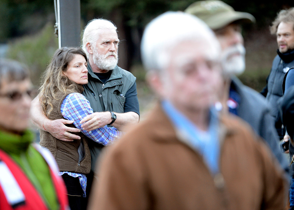 . Rebecca Bacon and her common law husband Hugh Milne embrace as they listen to news of the Pfeiffer Ridge Fire during the community meeting in Big Sur, Calif. on Friday December 20, 2013. Th pair live on nearby Clear Ridge and made it through with their home intact. (Photo David Royal/ Monterey County Herald)