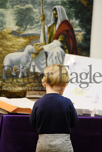 Harold Aughton/Butler Eagle: Athanasius Stanish, 19 months, explores a makeshift altar for children at St. Fidelis of Sigmaringen.
