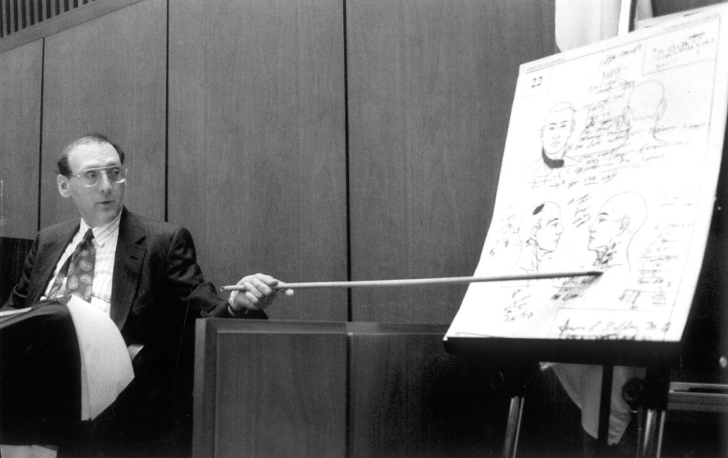 . Medical examiner Dr. Irwin L. Golden, testifying, points to a diagram showing the location of wounds to Nicole Brown Simpson.   (7/8/94)   (Los Angeles Daily News file photo)
