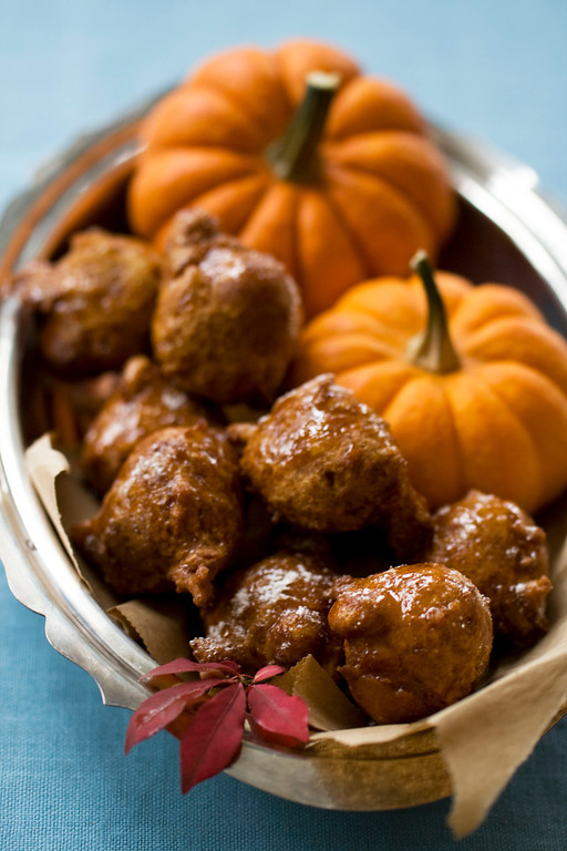 . This Oct. 7, 2013 photo shows pumpkin honey doughnuts in Concord, N.H. To help bridge the holidays of Hanukkah and Thanksgiving, this recipe combines the classic fried doughnut from Hanukkah and pumpkin pie from Thanksgiving, into one delicious treat. (AP Photo/Matthew Mead)