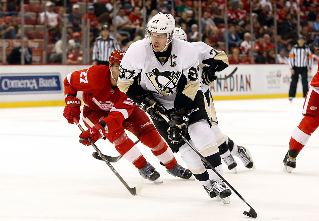 . Pittsburgh Penguins center Sidney Crosby (87) skates against the Detroit Red Wings in the third period of a NHL preseason hockey game in Detroit Wednesday, Oct. 1, 2014. (AP Photo/Paul Sancya)