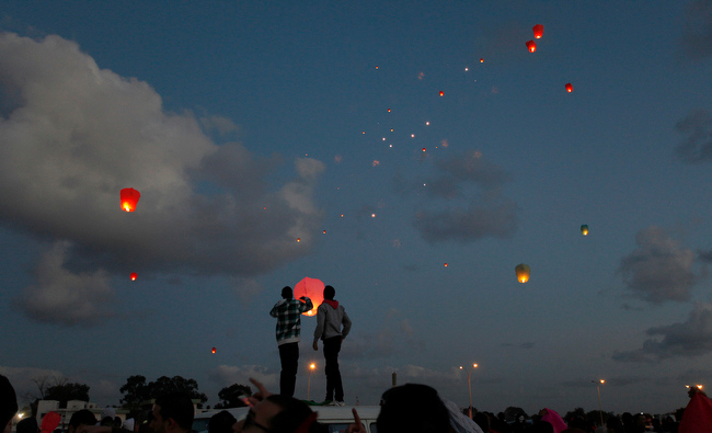 . Libyans release lanterns into the air,  at Nasr Square, during the second anniversary of the uprising that toppled longtime dictator Moammar Gadhafi in Benghazi, Libya, Sunday, Feb, 17, 2013.  (AP Photo/Mohammad Hannon)