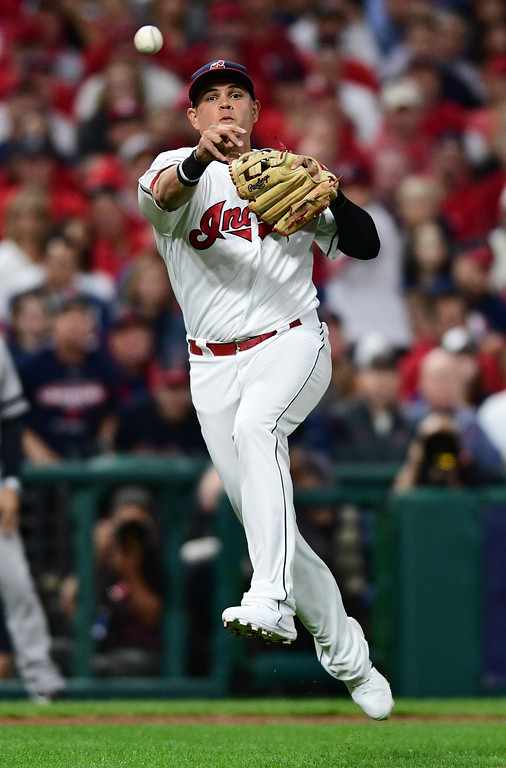 . Cleveland Indians\' Giovanny Urshela throws to first base to get New York Yankees\' Starlin Castro out during the second inning of Game 1 of a baseball American League Division Series, Thursday, Oct. 5, 2017, in Cleveland. (AP Photo/David Dermer)