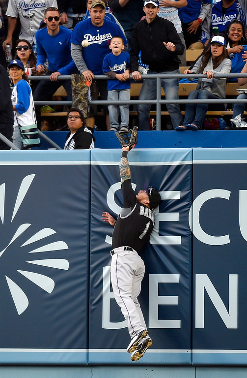 . Colorado Rockies center fielder Brandon Barnes can\'t get to a solo home run by Los Angeles Dodgers\' Matt Kemp during the third inning of a baseball game, Saturday, April 26, 2014, in Los Angeles. (AP Photo/Mark J. Terrill)