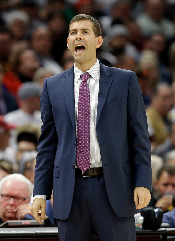 . Boston Celtics head coach Brad Stevens reacts in the first half of an NBA basketball game against the Cleveland Cavaliers, Tuesday, Oct. 17, 2017, in Cleveland. (AP Photo/Tony Dejak)