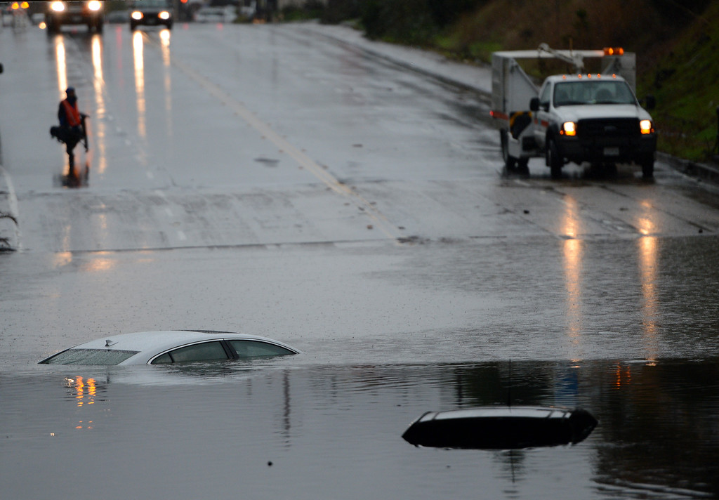 . Car roofs protrude above the floodwaters at the Ashby Avenue railroad underpass in Berkeley, Calif., on Thursday, Dec. 11, 2014. At least three cars were stranded. (Kristopher Skinner/Bay Area News Group)
