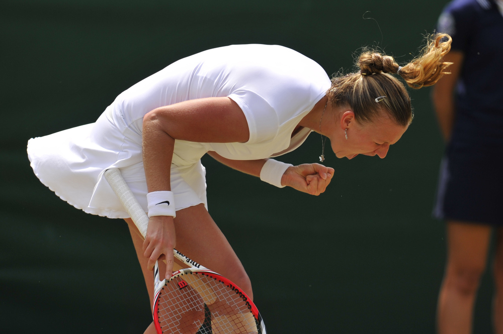 . Czech Republic\'s Petra Kvitova celebrates winning the first set against Spain\'s Carla Suarez Navarro during their fourth round women\'s singles match on day seven of the 2013 Wimbledon Championships tennis tournament at the All England Club in Wimbledon, southwest London, on July 1, 2013. Kvitova won 7-5, 6-3.  GLYN KIRK/AFP/Getty Images