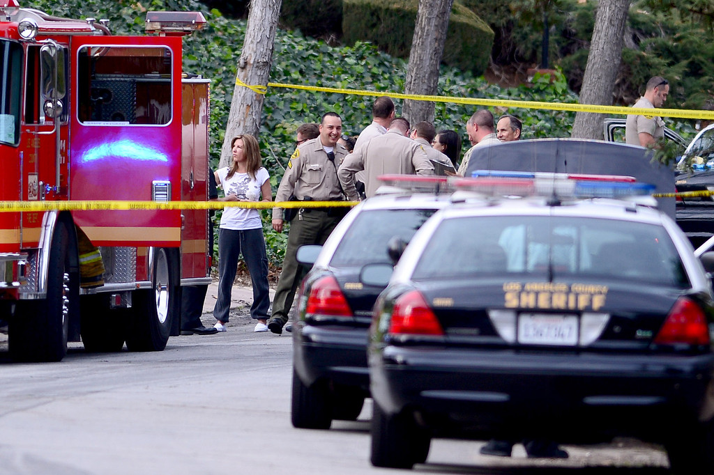 . Los Angeles County Sheriff investigate the scene of a burglary with vandalism where they found a possible suspect in a vehicle on fire in the driveway of the home on Rancho La Carlota Road in Covina Thursday, February 27, 2014.(Photo by Sarah Reingewirtz/Pasadena Star-News)