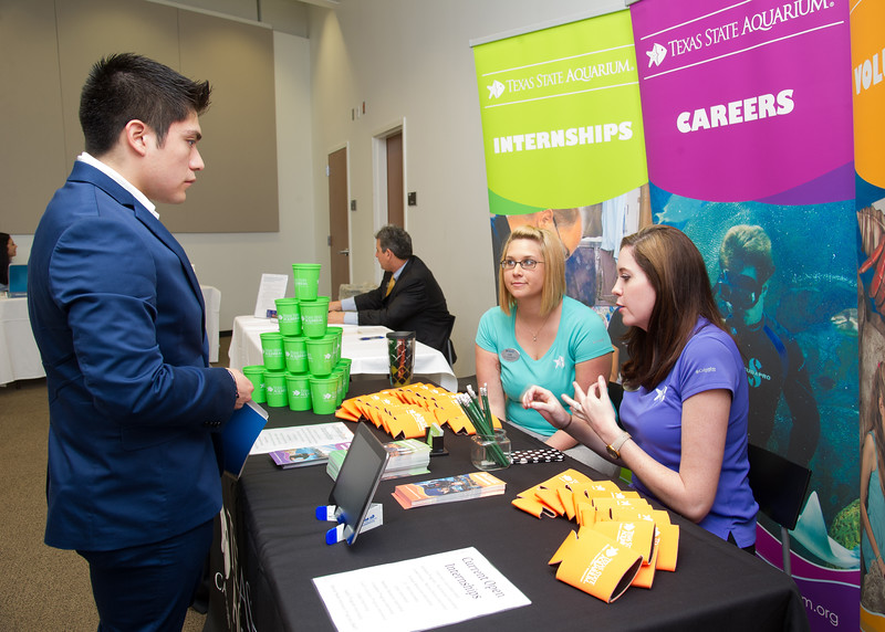 Student Francisco Hernandez learns about the internships offered at the Texas State Aquarium at the Internship Fair.