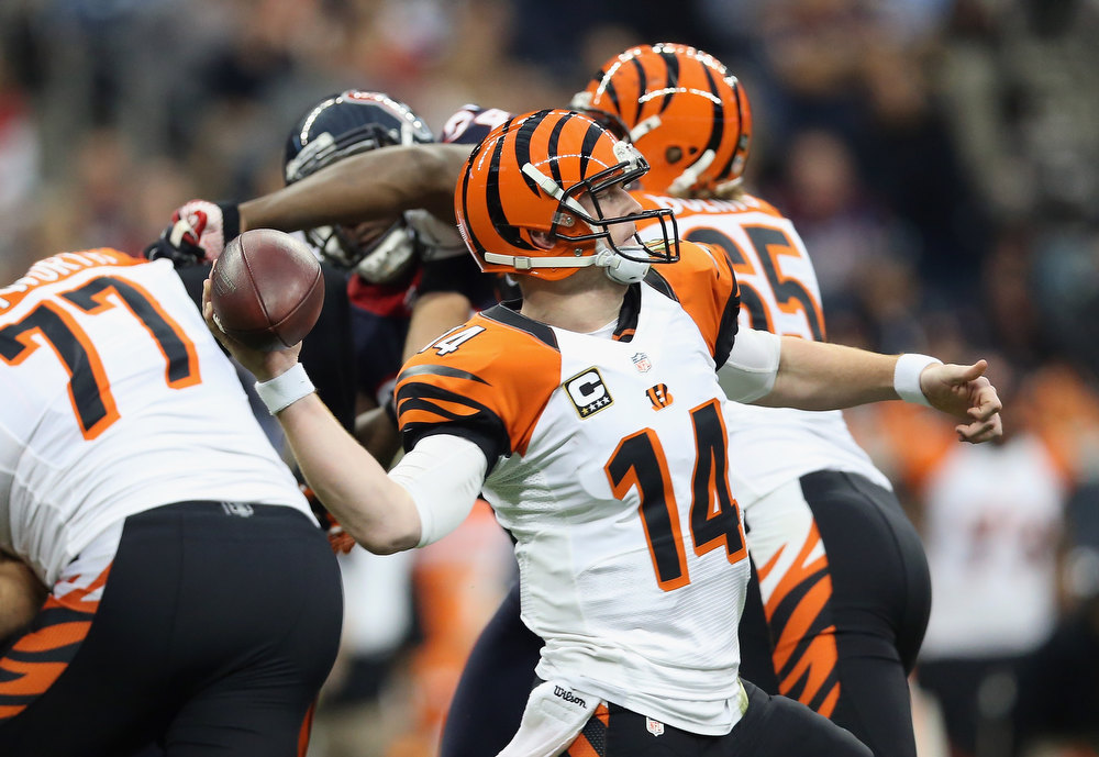 . Andy Dalton #14 of the Cincinnati Bengals throws the ball against the Houston Texans during the AFC Wild Card Playoff Game at Reliant Stadium on January 5, 2013 in Houston, Texas.  (Photo by Ronald Martinez/Getty Images)
