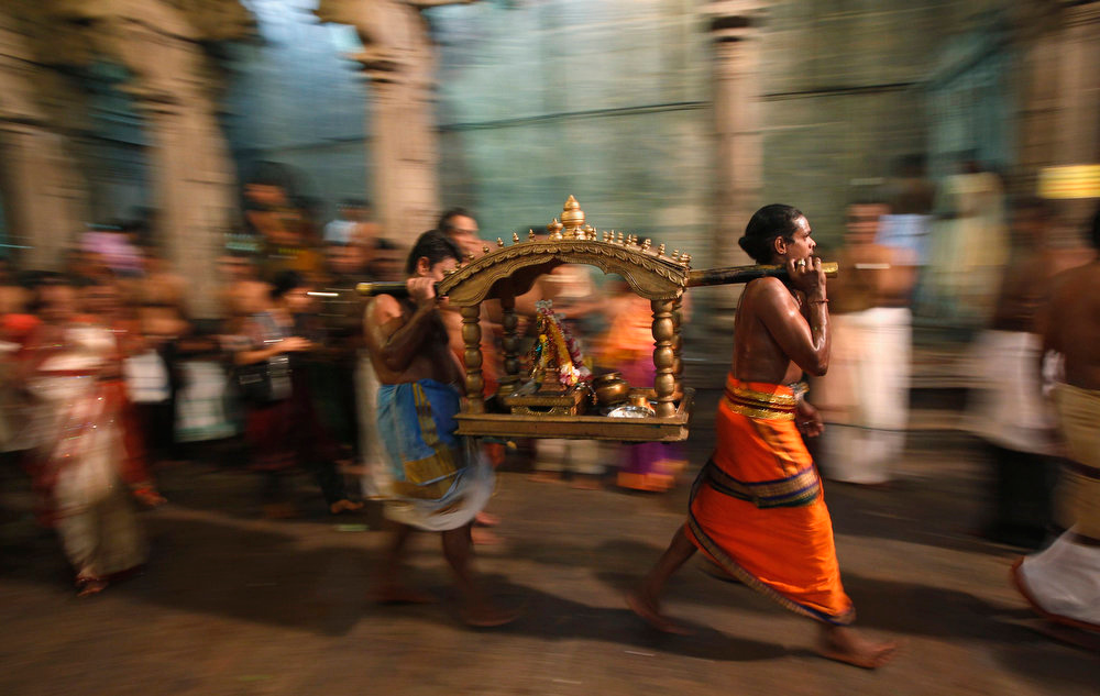 . Priests carry a shrine of Lord Shiva, a Hindu deity, to bless devotees as they pray during the annual Maha Shivaratri festival at Shivam Kovil in Colombo March 10, 2013. Sri Lanka\'s Hindu devotees celebrate the annual Maha Shivaratri festival by fasting for an entire day and holding a night long vigil at Hindu temples island wide. REUTERS/Dinuka Liyanawatte