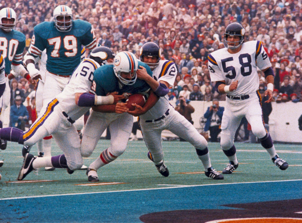 Description of . Miami Dolphins Larry Csonka racing through the Minnesota Vikings line. Miami defeated the Vikings 14-7 to win Super Bowl VIII, at the Los Angeles Coliseum, January 14, 1974  (AP Photo)