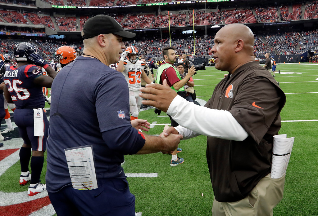 . Houston Texans head coach Bill O\'Brien, left, and Cleveland Browns head coach Hue Jackson, right, meet at midfield after their NFL football game, Sunday, Oct. 15, 2017, in Houston. (AP Photo/Eric Gay)